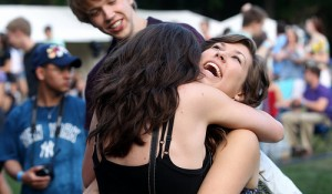 Students embrace on Alumni Lawn during Rites of Spring 2012