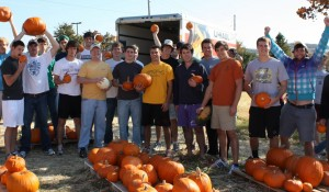 Members of the Signma Chi fraternity give their time to a fundraiser at a local pumpkin patch.
