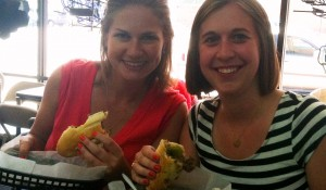 Admissions counselors Sarah Quin and Laura Sensenig enjoying a couple of authentic Philly cheesesteaks on last year's Road Show trip.