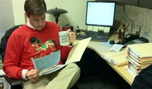 Admissions Counselor Ben Gatlin gets some last minute reading in before the holidays.