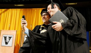 A member of the Class of 2014 snaps a quick selife with Chancellor Nick Zeppos after receiving his diploma. (John Russell/Vanderbilt University)
