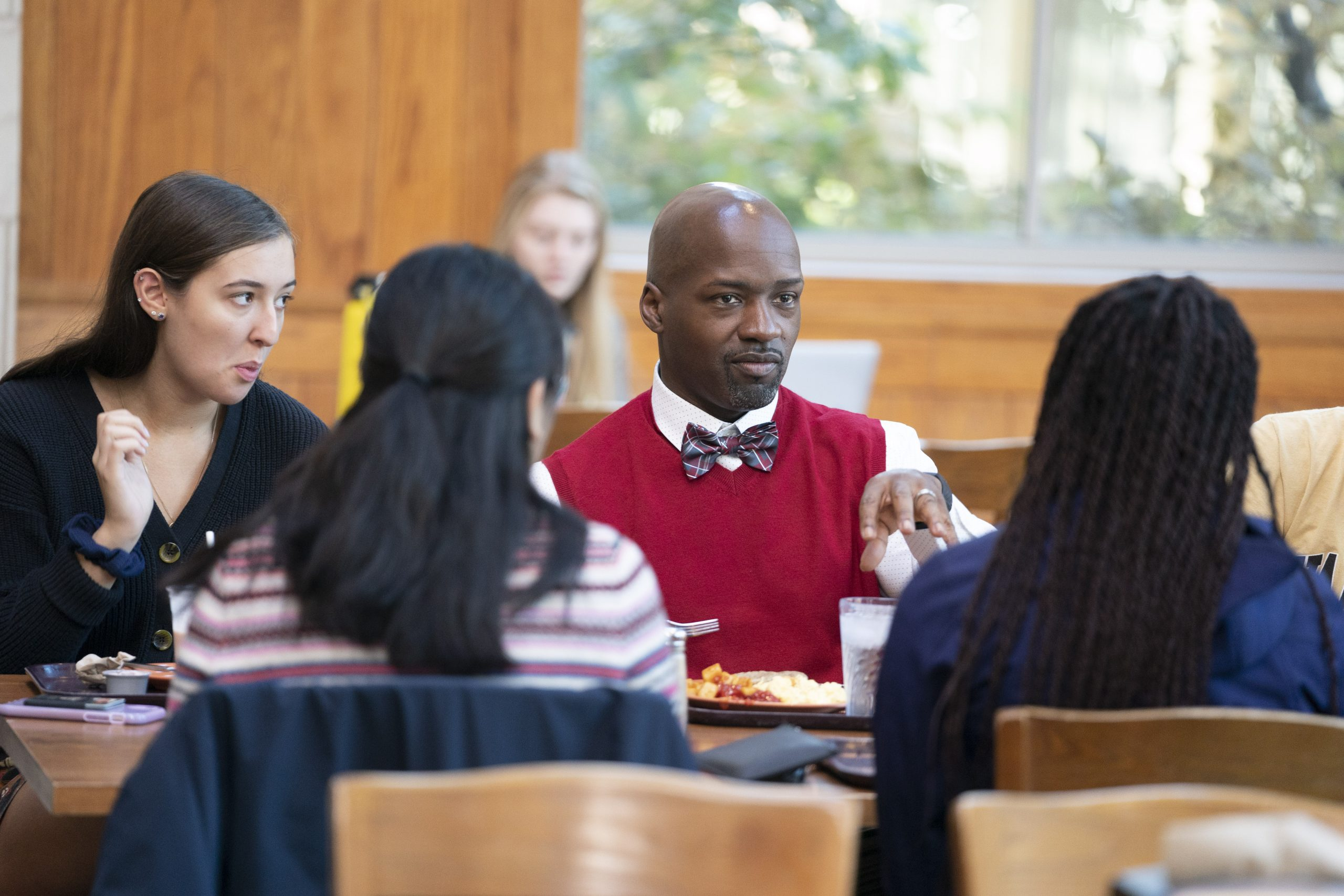 students in the dining hall with a professor