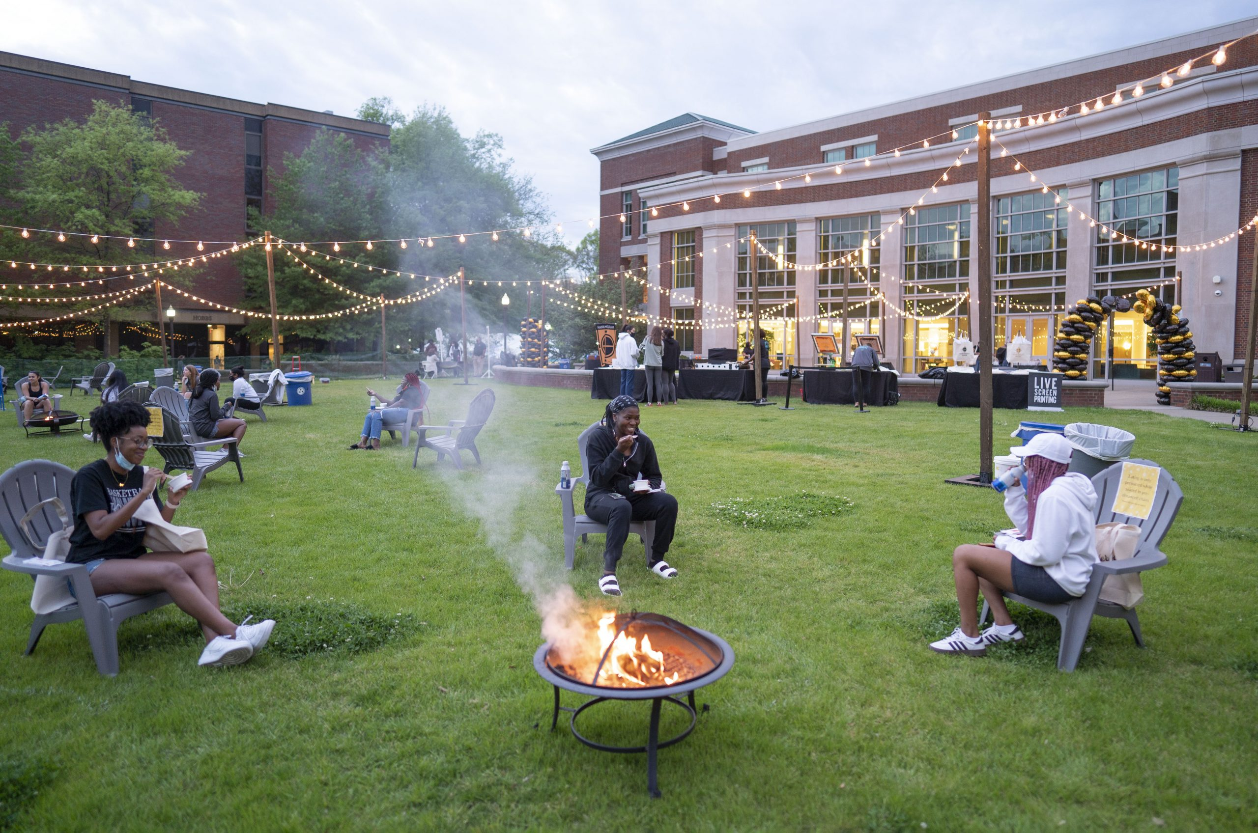 students gathered around a fire pit on The Commons